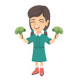 caucasian girl laughing and holding broccoli vector image