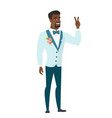 african groom showing the victory gesture vector image vector image