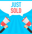 hand holding megaphone with just sold announcement vector image vector image