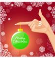 Woman hand with Christmas ball vector image