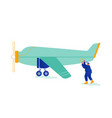service engineer repair vintage airplane with vector image vector image