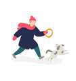 a girl playing with a dog girl teenager in coat vector image vector image