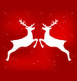 reindeer on a red glittering christmas backgroun vector image