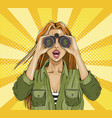 pop art surprised woman with binoculars with a vector image vector image