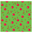 red apples and cherries on bright green vector image