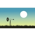 Silhouette of windmill and grass landscape vector image vector image