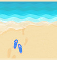 flip flops and footsteps on the sand vector image vector image