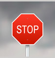 red stop sign on gray sky background vector image