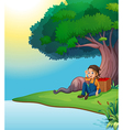 A young boy relaxing under the tree vector image vector image
