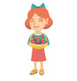 girl with the basket of strawberry and blueberry vector image