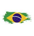grunge brush stroke with brazil national flag vector image