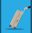 travel bag in hand trolley on wheels vector image vector image