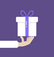 hand holding white gift box donation vector image vector image