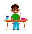 multiethnic boy at school desk in classroom vector image vector image
