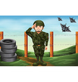 A soldier in front of the barbwire fence vector image vector image