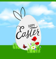 Happy easter greeting card easter egg over field