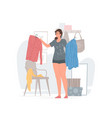 young woman choosing clothes in morning at home vector image