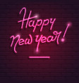 happy new year neon purple text on brick wall vector image vector image