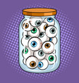human eyes in glass jar pop art vector image vector image