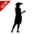 woman silhouette make a photo with phone vector image vector image