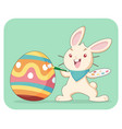 light brown rabbit painting easter egg vector image vector image