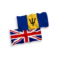flags great britain and barbados on a white