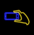 hand with smartphone making photo neon sign vector image
