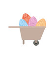 wheelbarrow with easter eggs isolated icon vector image