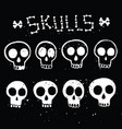 set white skulls in ink on black vector image vector image