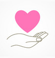 hand holding a heart shape symbol vector image