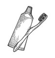 toothbrush and toothpaste engraving style vector image vector image