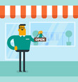 caucasian white shop owner holding open signboard vector image vector image