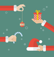 Santa claus hand holding christmas objects vector image