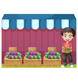 A boy selling grapes vector image vector image