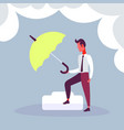 businessman hold green umbrella colorful risk vector image vector image