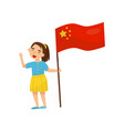 girl holding national flag of china design vector image vector image