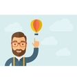 Man pointing the hot air balloon icon vector image