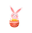cute rosy easter bunny sitting in broken egg shell vector image vector image