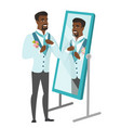 groom looking in the mirror and adjusting tie vector image vector image