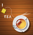 a cup of hot tea and tea bag with steam vector image vector image
