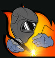 welder in a mask with a tool in his hands vector image vector image