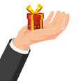 the hand that holds the box gift cartoon style vector image vector image
