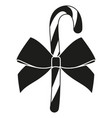 black and white candy cane with bow silhouette vector image vector image