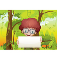 A forest with a young boy holding an empty signage vector image vector image
