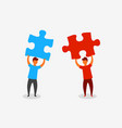 two flat style people connecting puzzle elements vector image vector image