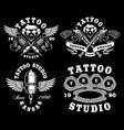 set of monochrome tattoo emblems on dark vector image