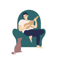 cute boy sitting in comfy armchair and playing vector image vector image