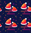 red santa hats and stars seamless pattern vector image vector image
