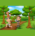 zookeeper boy and girl with animals in the jungle vector image