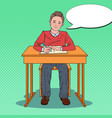 pop art happy schoolboy sitting at school desk vector image vector image